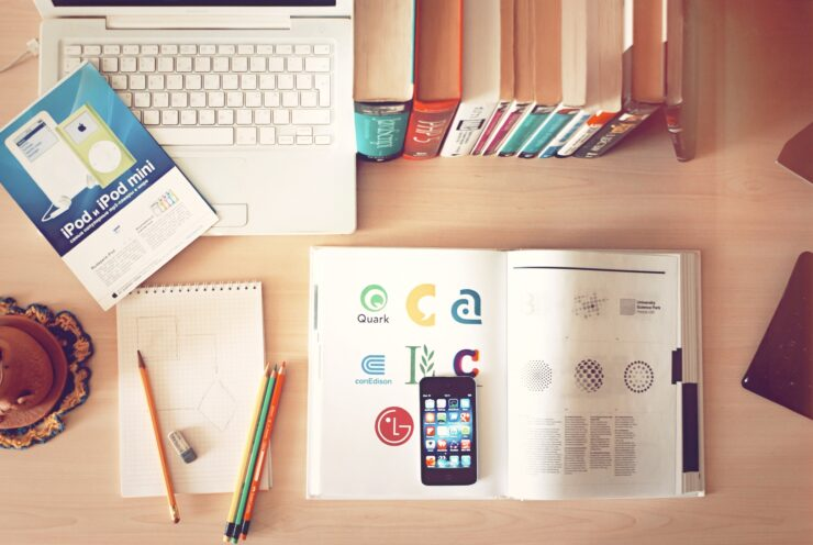 This photo of webdesigners  workplace shows how it is really hard to create a modern webdesign because you need to adapt design to devices, use icons and read many books to create simple design