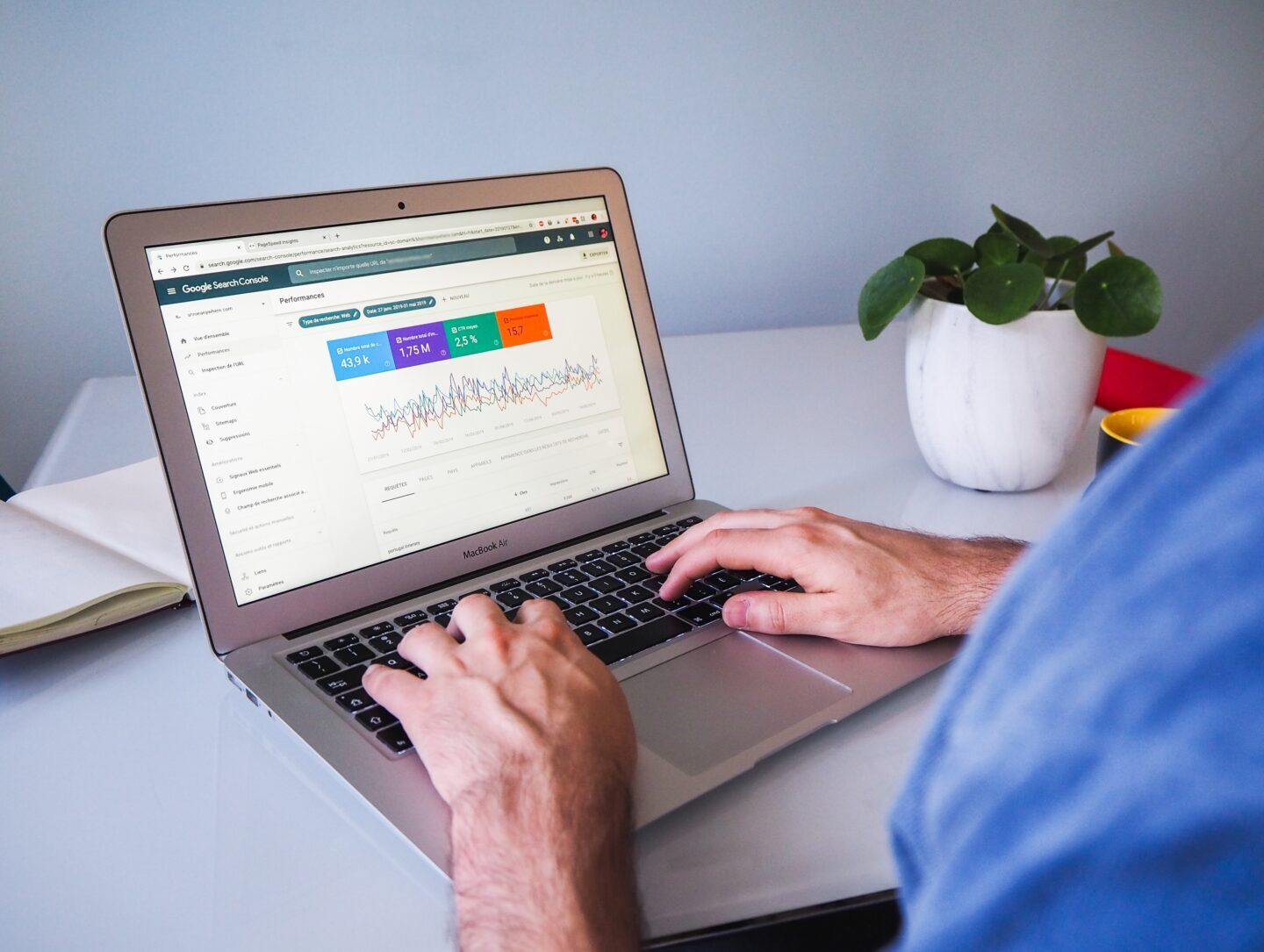 The man use a laptop to check the data from Google search Console that helps him to provide SEO audit of a site