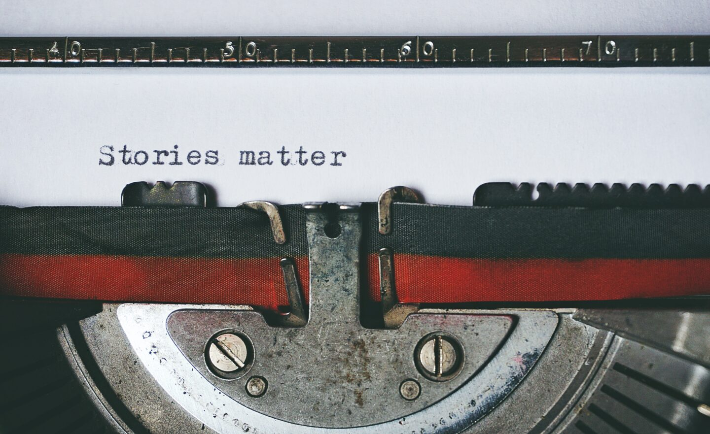 The tyewriter with paper and printed words stories matter