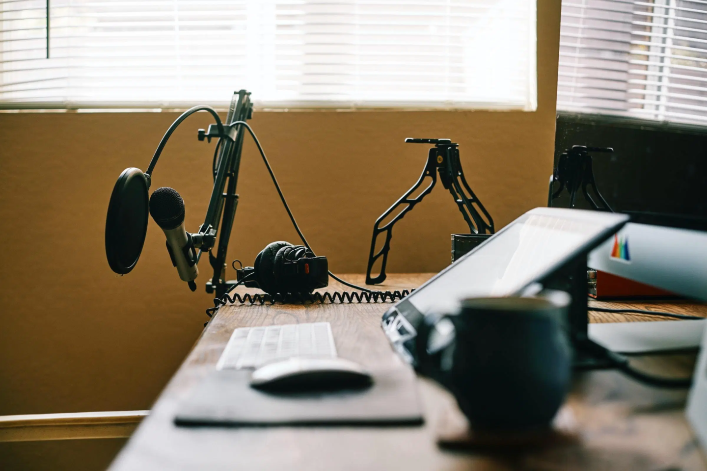 Microphones and other equipment on desk to record podcast remotely