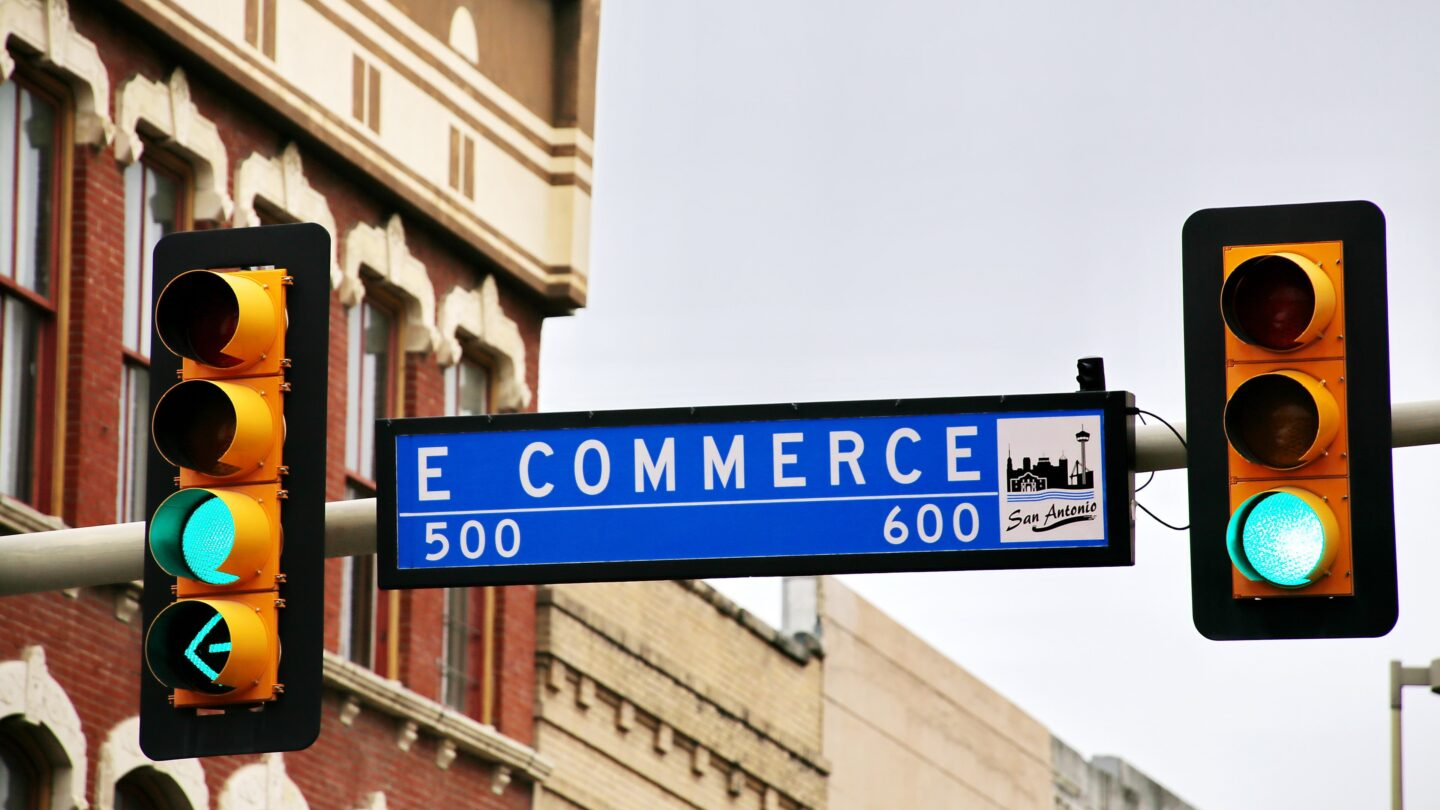 Traffic lights and sign with ecommerce caption symbolyze the ecommerce business journey