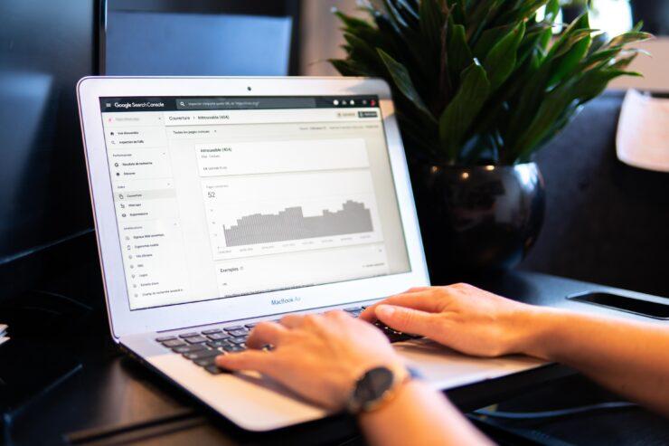 A person check Google Search Console report on a white laptop