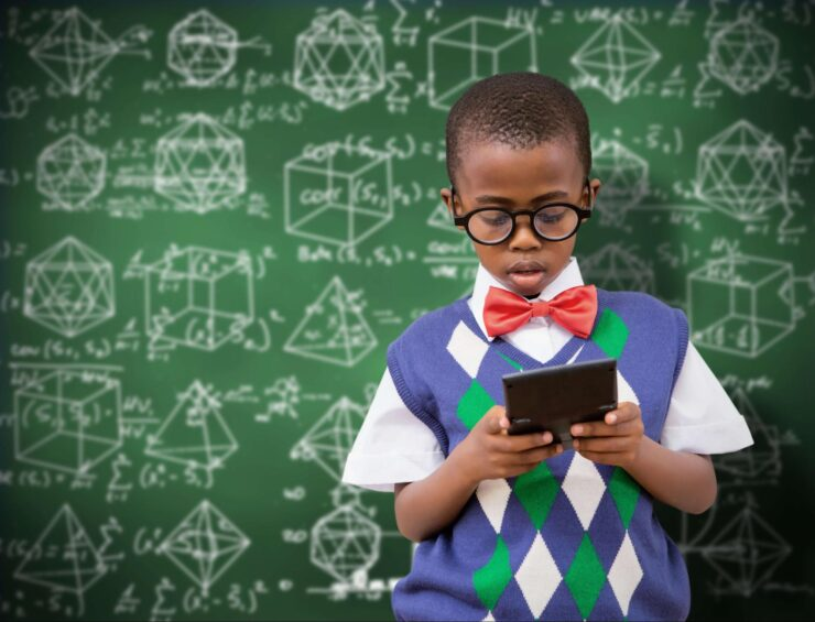 A boy in upfront of the board of education. and he is holding a tablet pc